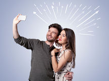 Cute couple taking selfie with arrows Stock Photo