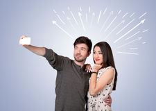 Cute couple taking selfie with arrows Royalty Free Stock Photos