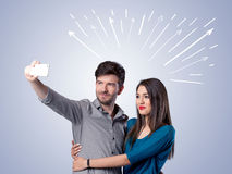 Cute couple taking selfie with arrows Stock Photography
