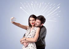 Cute couple taking selfie with arrows Royalty Free Stock Image