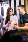 Cute couple talking in a bar Royalty Free Stock Images