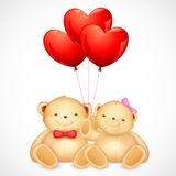 Cute Couple of Teddy Bear holding Heart Balloon Stock Photos