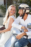 Cute couple with their scooter Stock Photo