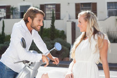 Cute couple with their scooter Stock Images