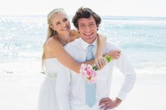 Cute couple on their wedding day smiling at camera Royalty Free Stock Image