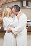 Cute couple about to kiss in bathrobes Royalty Free Stock Photo