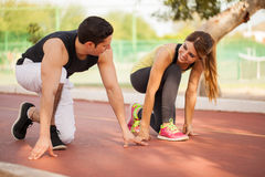 Cute couple about to race each other Royalty Free Stock Photos