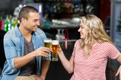 Cute couple toasting with beers Royalty Free Stock Photo