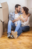 Cute couple toasting with champagne on floor Stock Photo