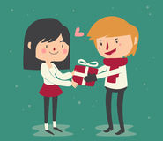Cute Couple Trading Gifts Royalty Free Stock Photos