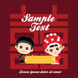 Cute couple in traditional Chinese wedding costume Royalty Free Stock Photography