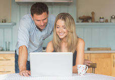 Cute couple using laptop together Royalty Free Stock Photography