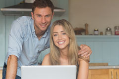 Cute couple using laptop together Royalty Free Stock Image