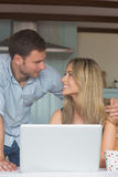 Cute couple using laptop together Royalty Free Stock Images