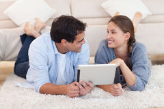 Cute couple using a tablet computer Stock Image
