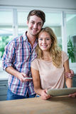 Cute couple using tablet computer in the kitchen Stock Image