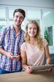 Cute couple using tablet computer in the kitchen Royalty Free Stock Images