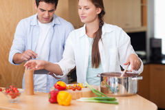 Cute couple using a tablet computer to cook Stock Photography