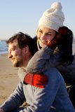 Cute couple in vacation on the beach during winter season Royalty Free Stock Photography