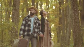 Cute couple walking in autumn park. Funny couple in the autumn park. Couple in retro old style. Sensual outdoor portrait. Of young stylish fashion couple in stock video footage
