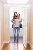 Cute couple walking through the door Stock Images