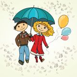 Cute couple walking in the rain Royalty Free Stock Photography