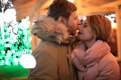 Cute couple in warm clothes. At winter fair royalty free stock photo