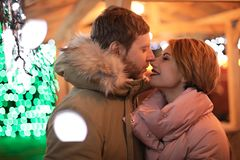 Cute couple in warm clothes. At winter fair stock photography