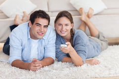 Cute couple watching TV stock photos