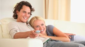 Cute couple watching TV stock video footage