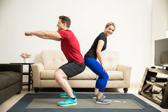 Cute couple working out together royalty free stock photo