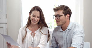 Cute couple working together on laptop stock footage