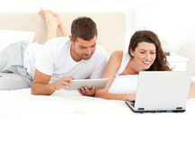 Cute couple working together on their laptop Royalty Free Stock Photos