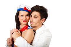 Cute couple of young man and woman. Passionate sexy young couple roleplay sailor and captain. Isolated on white background. High resolution studio image Royalty Free Stock Photos