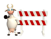 Cute Cow cartoon character with baracades Stock Photos