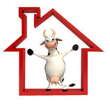 Cute Cow cartoon character with home sign Royalty Free Stock Image