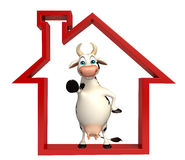 Cute Cow cartoon character with home sign Stock Photo