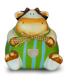 Cute cow-shaped piggy bank in decorated ceramic Stock Image