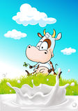 Cute cow sitting on green grass with milk splash Royalty Free Stock Image