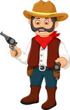 Cute cowboy cartoon holding a gun Royalty Free Stock Image
