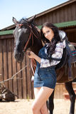 Cute cowgirl on ranch Stock Images