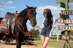 Cute cowgirl on ranch Royalty Free Stock Image