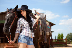 Cute cowgirl on ranch Royalty Free Stock Photography