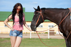 Cute cowgirl on ranch Stock Photos