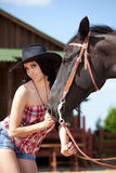 Cute cowgirl on ranch Stock Photo