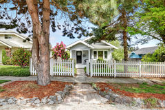 Cute craftsman home exterior with picket fence. Northwest, USA royalty free stock images