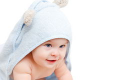Cute crawling baby. Cute baby with towel on white Royalty Free Stock Photography