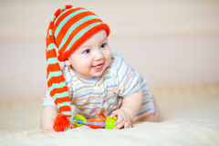 Cute crawling baby boy indoors stock images