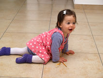 Cute crawling baby toddler girl Stock Photos