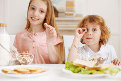 Cute creative children having cereal for breakfast royalty free stock photos
